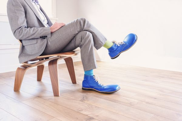 man in a suit with clown shoes