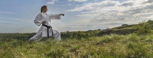 black belt woman outside | mastering the role of integrator
