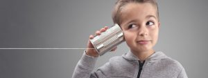 boy with a tin can phone | get more productivity from your remote team