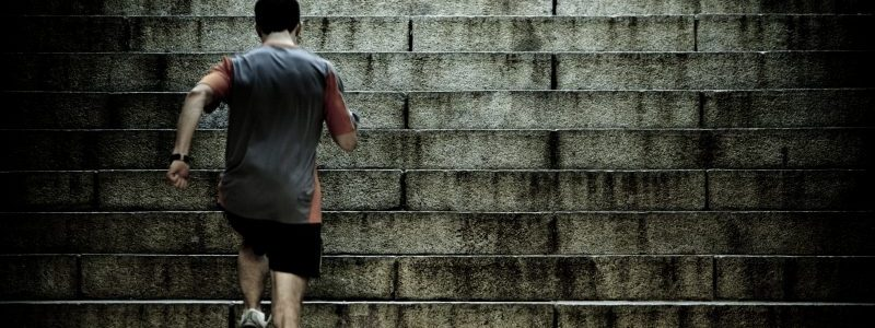 man running up stairs | Michael Erath - Rise