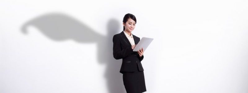 Superhero Business Woman with tablet   case study remote team boosts EOS efficiency