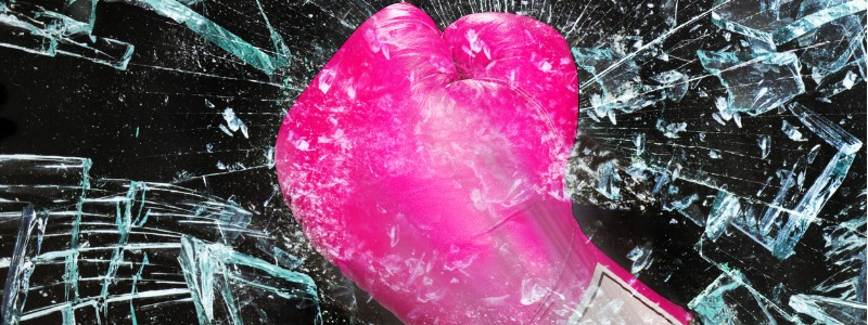 pink boxing glove shattering glass | sue hawkes shatters imposter syndrome