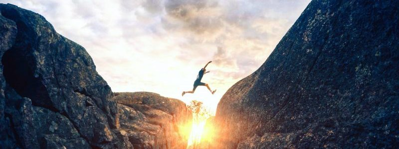 man jumping over crevasse | TechMD success with Traction Tools