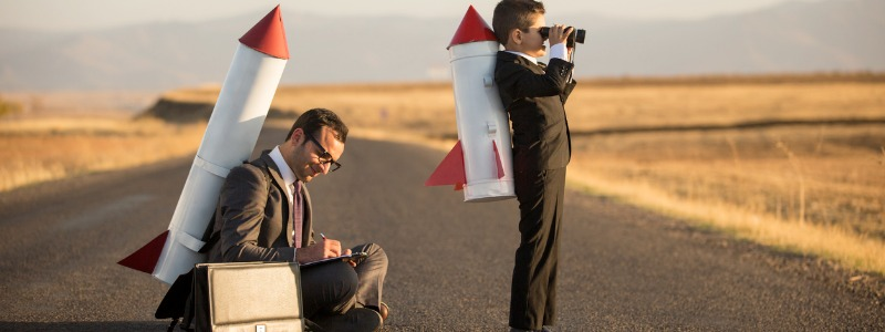 Boy and man in business suits with rocketpacks on their backs | Mark C. Winters Talks About Rocket Fuel